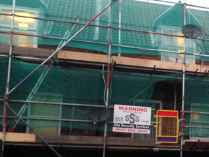 Scaffolding with site security warning